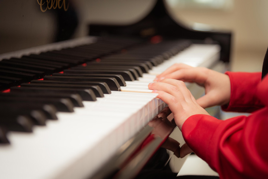 close up of kids playing piano