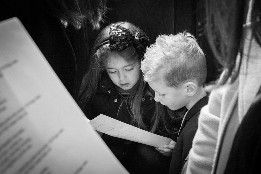 two kids reading a lyric script
