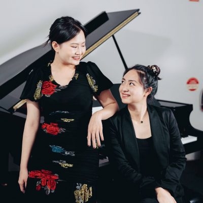 student enjoying piano class with the teacher